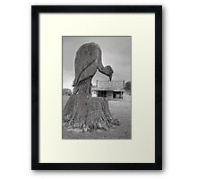the bird who guard the old store Framed Print
