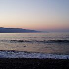 Lemon pink sunset over sea in Crete with lilac mountains by Grace Johnson