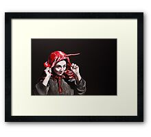 With a wry smile, she called your bluff Framed Print