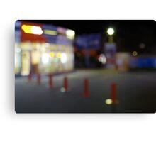 Defocused night urban scene with blurred lights Canvas Print