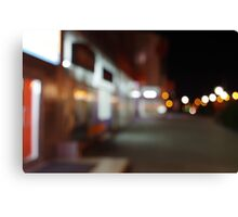 Night urban scene with diffuse lighting shop windows Canvas Print