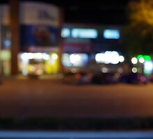 Night urban scene with blurred lights and the shopping center by vladromensky