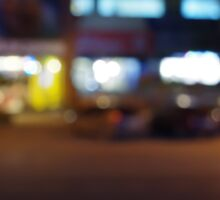 Night urban scene with blurred lights and the shopping center Sticker