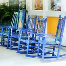 Row of Blue Rocking Chairs by Susan Savad