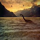 Toy dinosaur in lake by Sandra Cunningham