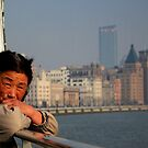 Crossing the Huangpu river, Shanghai, China. by David Mellor