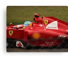 Fernando Alonso's Ferrari exits the pits Canvas Print