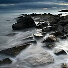 Incoming tide on a rocky promontory, Crail, Fife, Scotland. by Colin Munro