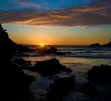 Porth Beach, Newquay, Cornwall, Rocks at sunset. by Colin Munro