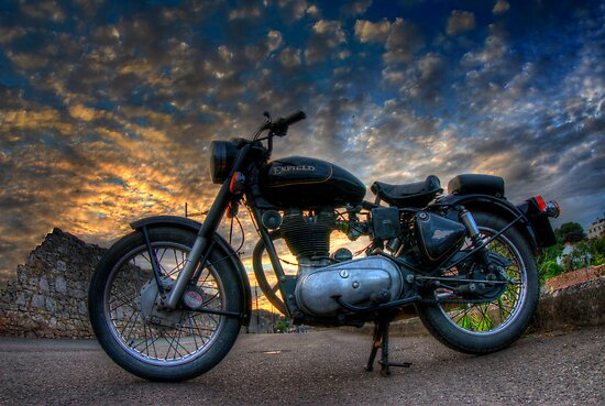 Enfield Bullet 500cc motorcycle at sunset.  by Colin Munro