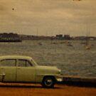 green car by Soxy Fleming