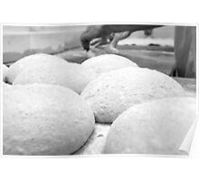 The shaped loaves are allowed to leaven before baking,  Poster