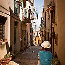 small sicilian street with sitting girl by wulfman65