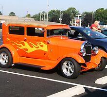 orange car by victoria miller