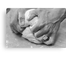 Hands of a baker kneading dough in a bakery at night.  Canvas Print