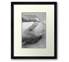 Hands of a baker kneading dough in a bakery at night Framed Print