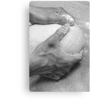 Hands of a baker kneading dough in a bakery at night Canvas Print