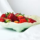 Fresh ripe strawberries on a plate  by torishaa