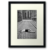 Laying on the ground Framed Print