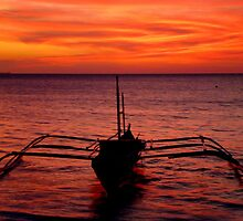 traditional fishing boat after sunset by supergold