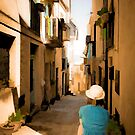small sicilian street with sitting girl - paint edit by wulfman65