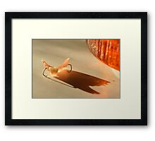 little monster is attacking me Framed Print