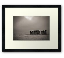 Stonehenge about to be engulfed in a snow storm Framed Print