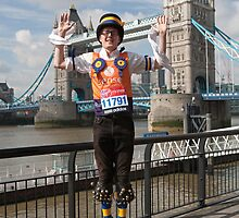 A morris Dancer at Tower Bridge ahead of the London marathon by Keith Larby