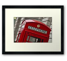 Top part of a red telephone box at an angle Framed Print