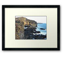 The blue sea saying hi to the rocks Framed Print