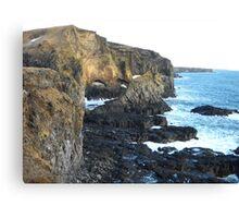 The blue sea saying hi to the rocks Canvas Print