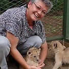 Yours truly, with lion cubs by Anita Deppe