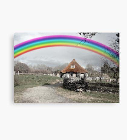 ancient rustic cottage with rainbow Canvas Print