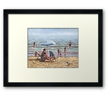 people on bournemouth beach parasol Framed Print