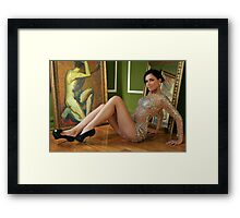 Pretty woman in vintage gown sitting on the floor Framed Print