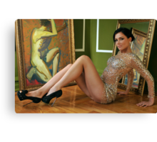 Pretty woman in vintage gown sitting on the floor Canvas Print