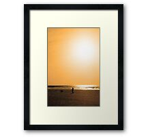 child and dog walking in golden sun shower Framed Print