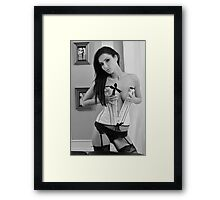 Portrait of sexy topless young lady in V shape corset  Framed Print