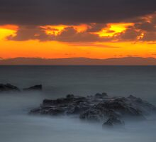 Tarifa Rocks and Tangerine Sky by AJM Photography