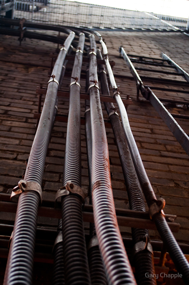 Pipes On A Wall by Gary Chapple
