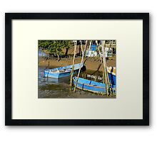 blue boats in the mud Framed Print