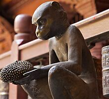 Brass monkey offering jackfruit, Patan, Nepal by John Spies