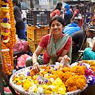 Flower seller, Kathmandu by John Spies