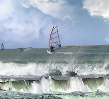 many surfers windsurfing in a storm by morrbyte