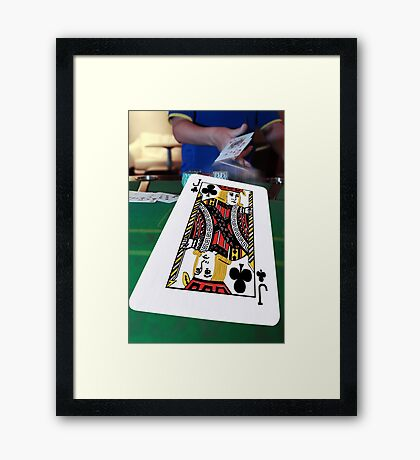 poker player throwing in the cards Framed Print