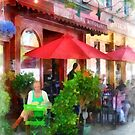 Outdoor Cafe With Red Umbrellas by Susan Savad