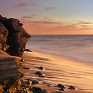 Sunset at the beach by camfischer