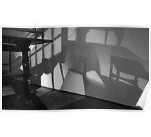 Table and chairs set on wall shadows Poster