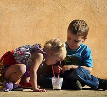sharing a milkshake by Clare Colins