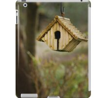 A birds' nest hangs from a tree iPad Case/Skin